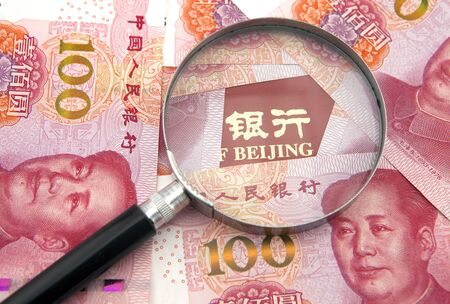 Banking concept, RMB banknote and magnifier