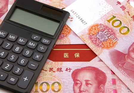 Medicare insurance concept, RMB banknote and calculator