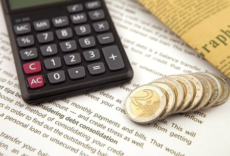 Coins and calculator on business documents