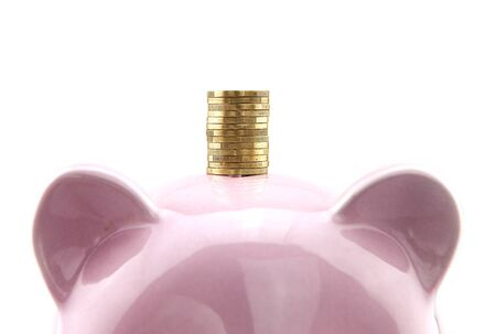Coin on top of piggy bank Imagens