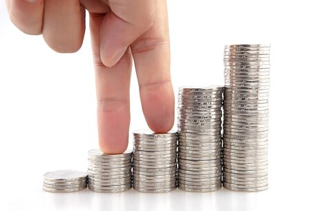 financial concept, Coins increasing under finger