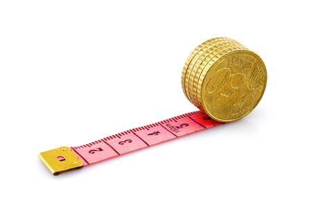 Euro coins on soft ruler 版權商用圖片