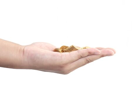 Hand holding coins Imagens
