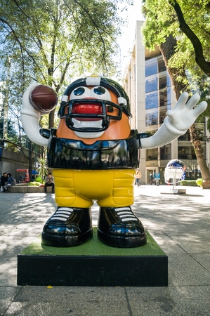 REFORMA AVENUE, MEXICO CITY - NOVEMBER, 13 2017. On the occasion of the match between Patriots and Raiders at the Aztec Stadium, the NFL organized the Ball Parade with 42 large-format pieces. Editorial
