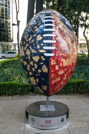REFORMA AVENUE, MEXICO CITY - NOVEMBER, 13 2017. On the occasion of the match between Patriots and Raiders at the Aztec Stadium, the NFL organized the Ball Parade with 42 pieces of 32 mexican artists. Editorial