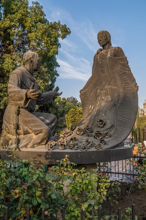 VILLA OF GUADALUPE, MEXICO CITY, DECEMBER 02, 2017.Sculpture of Juan Diego and Fray Juan de Zumarraga in the gardens of the Villa of Guadalupe. Editorial