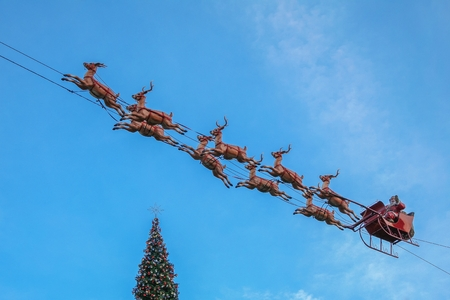 LOS ANGELES, CALIFORNIA, USA, NOVEMBER 26, 2006 - A figure of Santa Claus in his sleigh pulled by his reindeer adorns the sky of The Grove Mall.