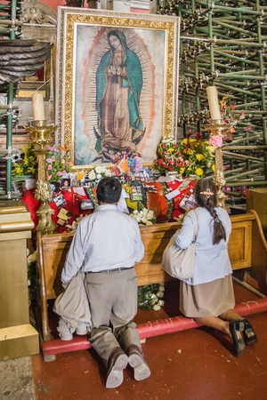 VILLA OF GUADALUPE, MEXICO CITY, AUGUST 08, 2008 - A couple of faithful believers pray to an image of the Virgin of Guadalupe on an improvised altar during the maintenance work of the Old Basilica.