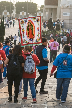 VILLA OF GUADALUPE, MEXICO CITY, DECEMBER 02, 2017 - Pilgrims from the Teofani region in Hidalgo, Mexico, carry a banner with the image of the Virgin of Guadalupe.