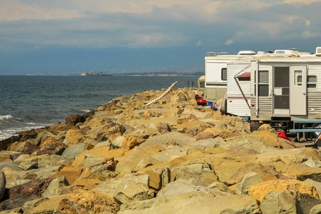 Recreational vehicles on the shore of the rocky beaches of Faria Beach National Park, in Ventura County, California.