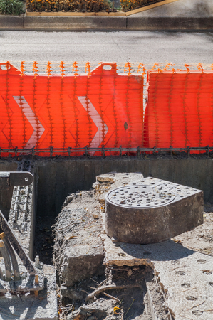 Take in vertical format of a sewer that is replaced on a sidewalk of Reforma Avenue during the construction works of Line 7 of the Metrobus of Mexico City.