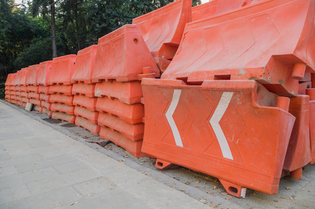 Take in horizontal format of several orange plastic structures stacked on South Insurgentes Avenue in Mexico City, used to create security barriers during construction and remodeling works. 版權商用圖片