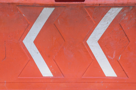Detail in horizontal format of an orange plastic structure used to create safety barriers during construction work and to direct or divert vehicular and pedestrian traffic. Shot taken in Mexico City. Stock Photo
