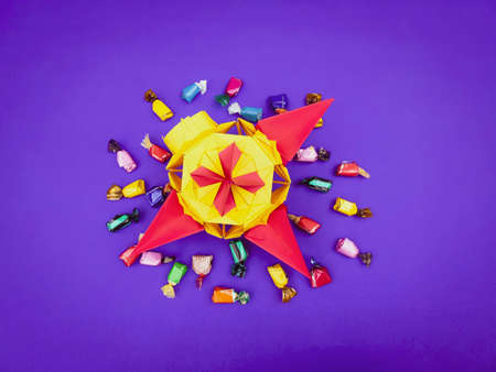origami piñata with colorful candies
