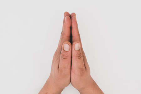 White background. Hands praying or asking for a favor Foto de archivo
