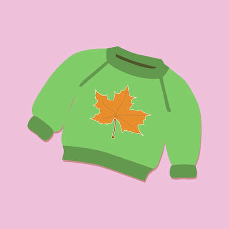 green knitted sweater with a yellow maple leaf depicted on it against a lilac background
