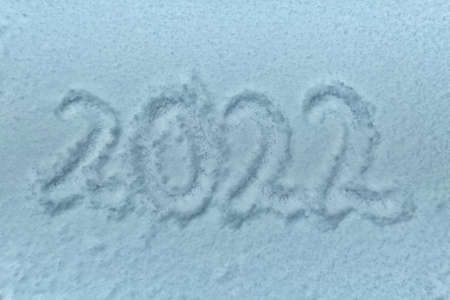 the inscription 2022 is written with a finger in the snow