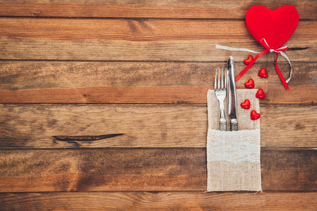 Table settings with hearts. Holiday background