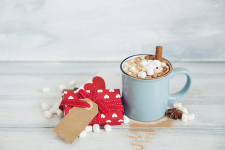 Hot chocolate with marshmallow and gift box