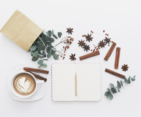 Notebook and coffee. Blogger or freelancer concept. Flat lay Stock Photo