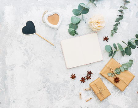 Flat lay composition with notebook and decorations. Wedding concept. Top view, copy space