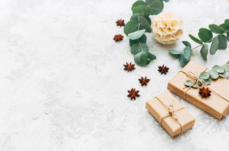Wrapped gift boxes with leaves. Flat lay, copy space. Holiday background Stock Photo