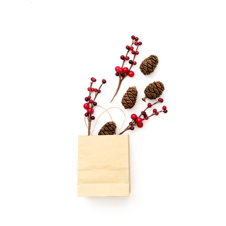 Christmas composition with bag and pine cones