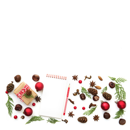 Creative natural layout made of winter things with christmas present on white background. Flat lay. Stock Photo