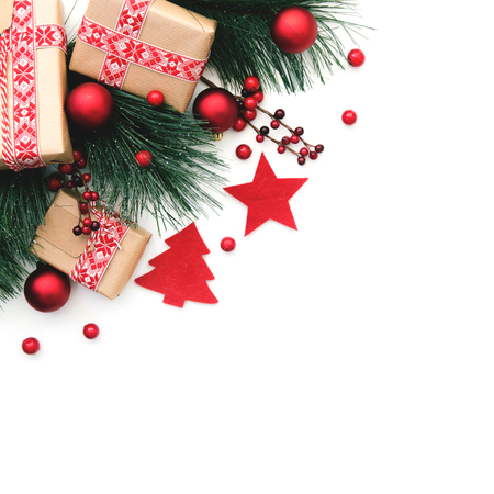 Christmas background. Fir tree branch and red christmas decorations on white background. Top view with copy space. Stock Photo