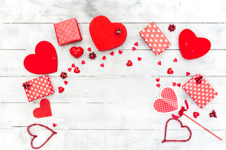 Valentines Day composition. Red hearts, gift box, on wooden background. Love or romantic concept. Flat lay, top view, copy space
