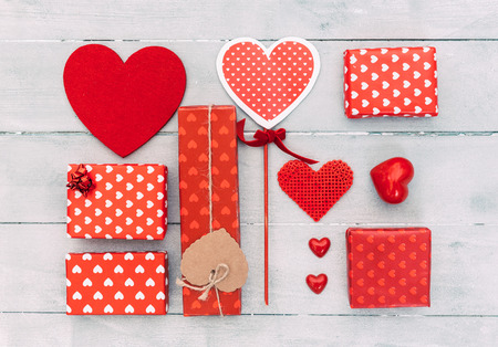 Top view of various gift boxes on wooden table. Happy Valentines Day scene