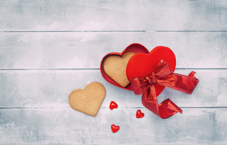 Open heart box with cookies. Valentines day background