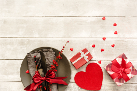Table setting with gift box. Valentines day card. Mothers day.  Stock Photo