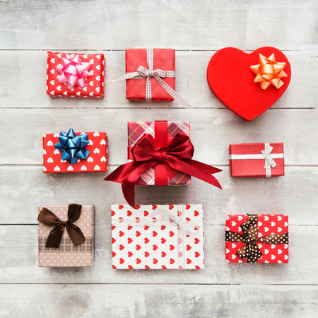 Flat Lay with Gift boxes, Ribbons, Decorations in red colors. Flat lay, top view