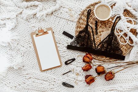 Lifestyle Fashion trendy women's underwear composition. Bra, coffee, on wool blanket, Flat lay, top view beauty blog minimal concept