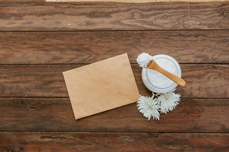 Organic healthy Coconut butter and fresh coconut pieces on wooden background copy space with empty blank