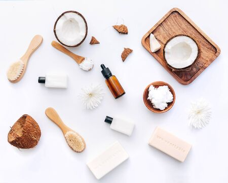 Flat Lay  Organic healthy coconut butter with coconut pieces over white background, body care products