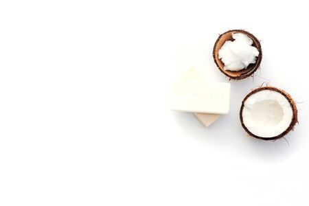 Top view Organic healthy coconut butter with soap and fresh coconut pieces over  white background Stock Photo