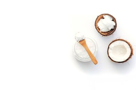 Top view Organic healthy coconut butter with fresh coconut pieces over  white background Stock Photo