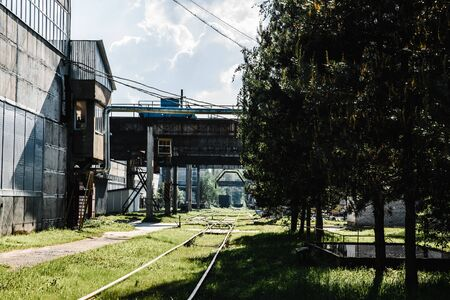 building of an old factory with railway tracks. loading heavy loads