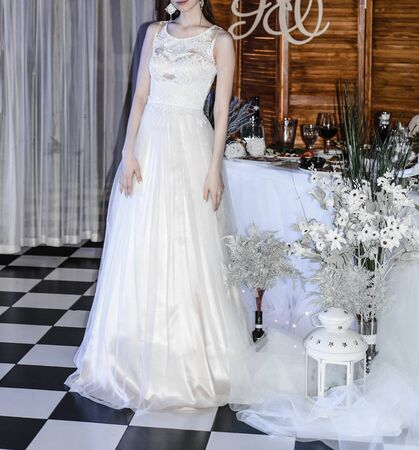 young slender bride in a long white elegant wedding dress. honeymoon ceremony