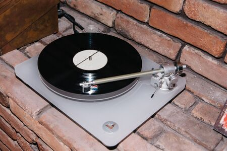 turntable for old vinyl records classic music at a loft dj party. gramophone, rare plates vintage style