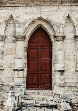entrance to the ancient wooden door of a gothic temple