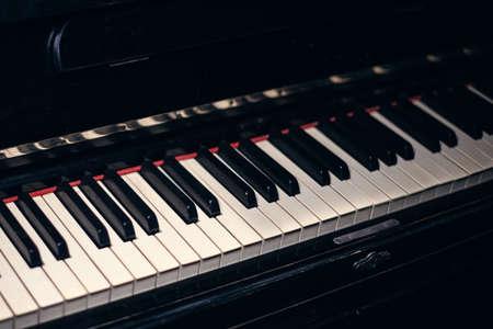 The old black piano. close-up of keys. Beautiful blur. Sepia Piano Keys