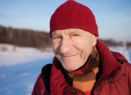 Old man outdoors. Winter time.  photo