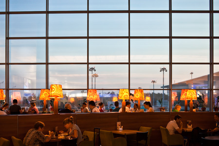 recreation area: People in restaurant at airport