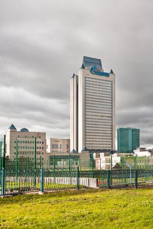 headquarter: Dark clouds over Gazprom tower headquarter. Moscow. Editorial