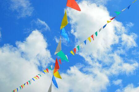 multi-colored flags in the blue sky Foto de archivo