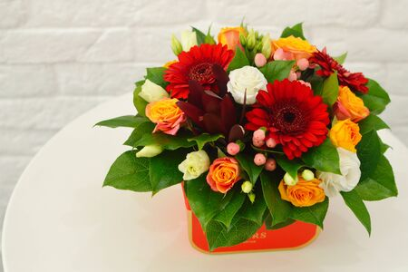 bouquet of flowers in red box