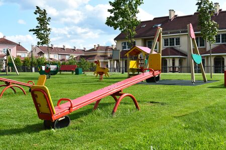Wooden swing on children playground. New playground in cottage settlement. Stok Fotoğraf
